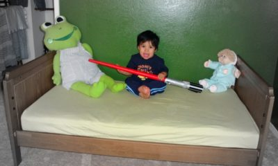 Boy sitting on IKEA toddler bed