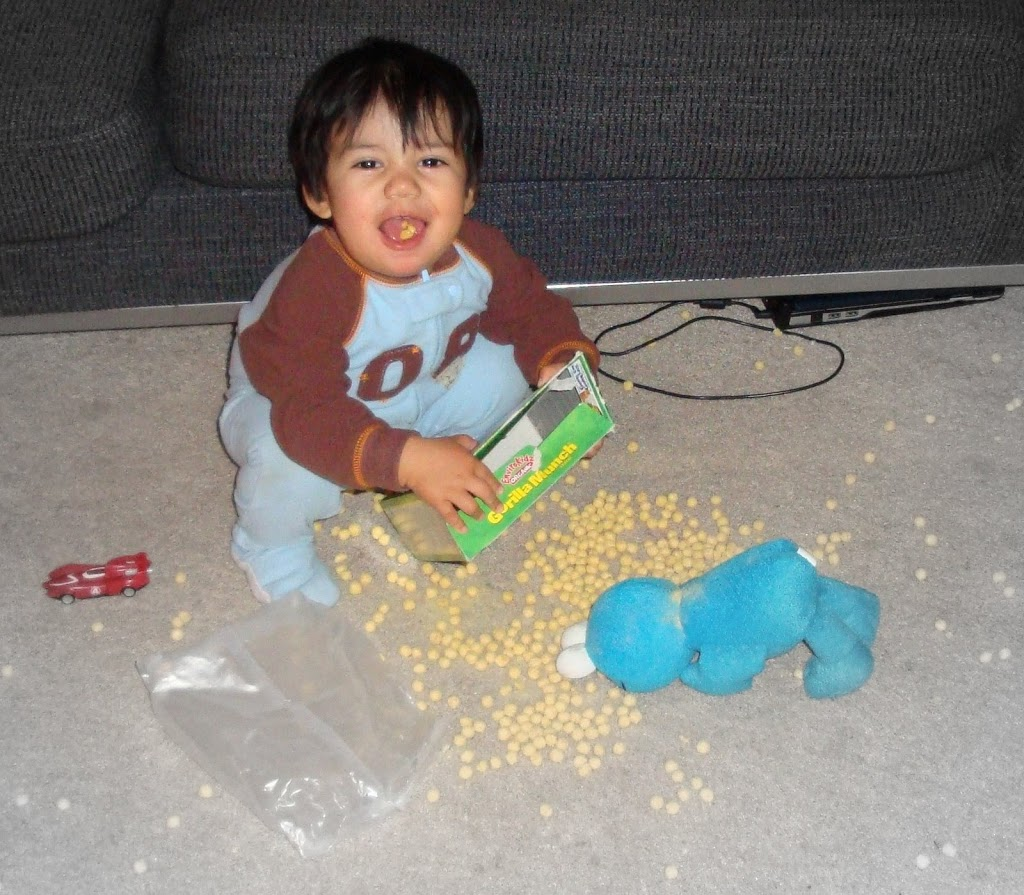 Baby playing with cereal