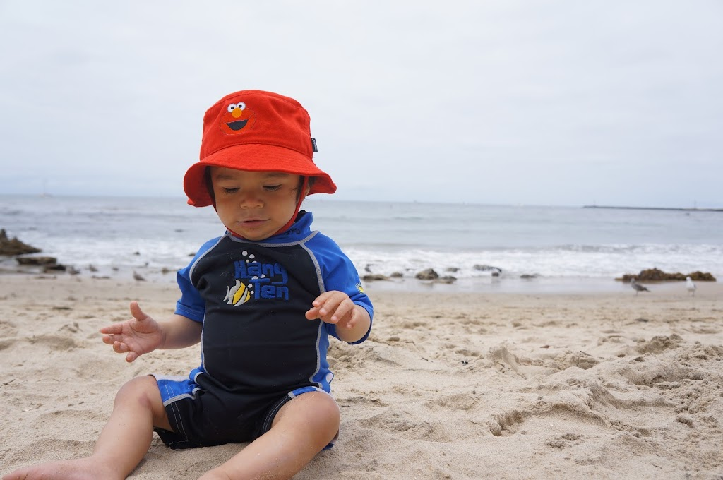 toddler sitting on the beach
