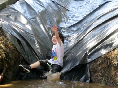 Sliding-down-mudslide-Adventure-Playground-Huntington-Beach