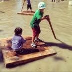 Kids playing on raft