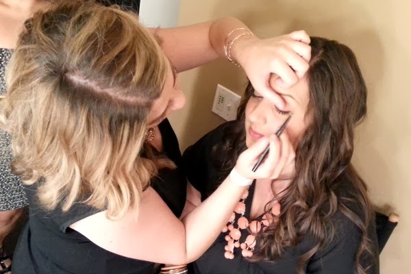 makeup artist applying eyeliner