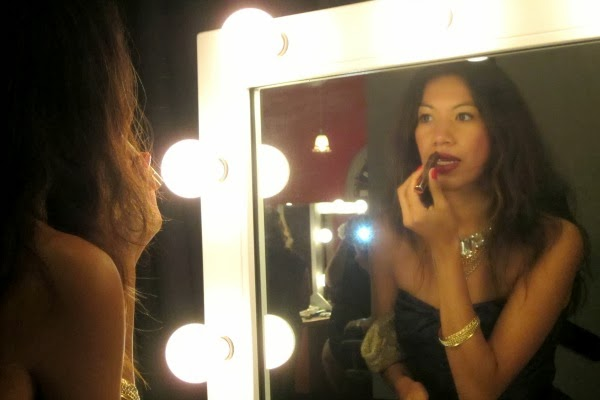 Applying lip color at COVERGIRL party
