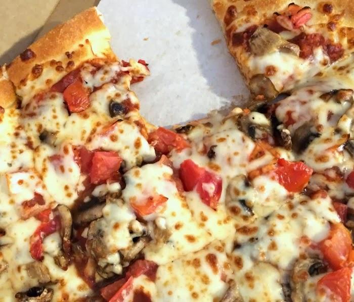 Pizza cut into squares   LivingMiVidaLoca.com #FreeBirdsPizzaParty