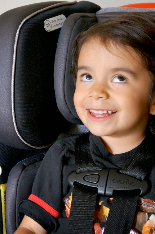 Boy sitting in Evenflo Symphony DLX Platinum Convertible car seat // #EvenfloPlatinum
