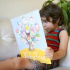 boy reading The Baby Tree