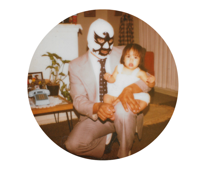 Lucha libre dad with baby