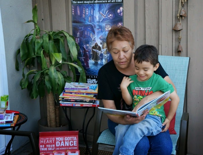 grandmother reading to grandson
