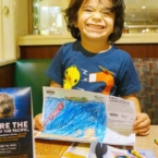 Boy eating at Denny's Diner