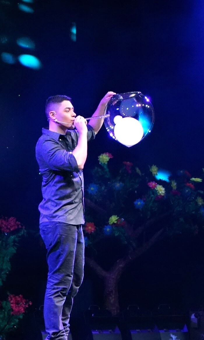 Deni Yang makes smoking bubbles during bubble show