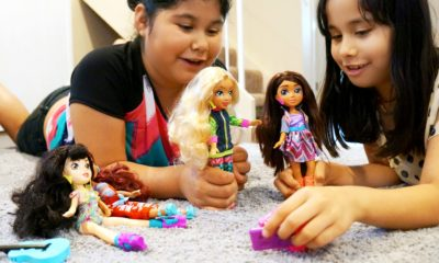 Latina girls playing with Vi and Va dolls collection