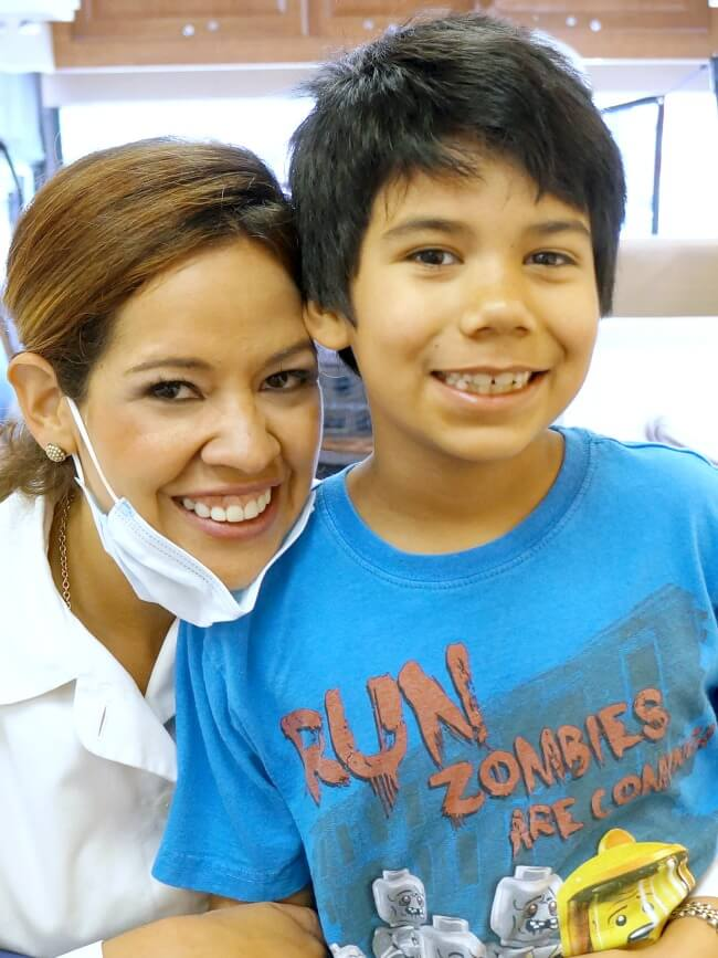 Logan Cordova with dentist