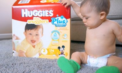 baby next to Huggies diaper box