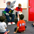 Kids reading at Chuck E. Cheese's
