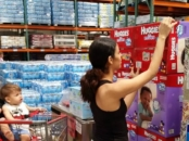 Latina buying Huggies little movers plus diapers at Costco