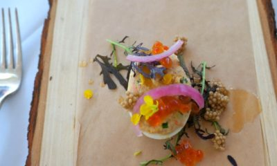Caramelized salmon deviled eggs, salmon caviar, pickled mustard seed, mustard frills