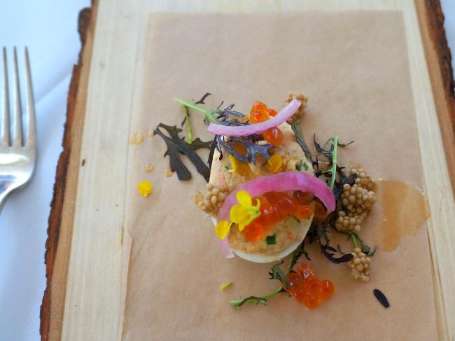 Caramelized salmon deviled eggs, salmon caviar, pickled mustard seed, mustard frills