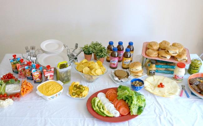 Hamburger bar, nachos, drinks and veggie tray