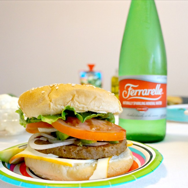 Vegetarian cheeseburger and Ferrarelle mineral water