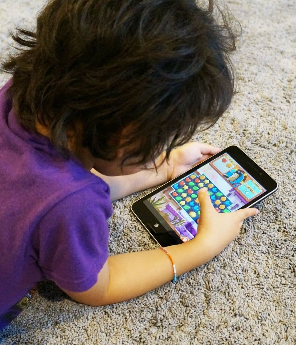boy playing with asus memo pad 7 lte