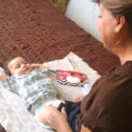 Latina grandma changing baby
