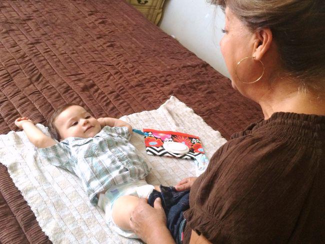 Latina grandma changing baby