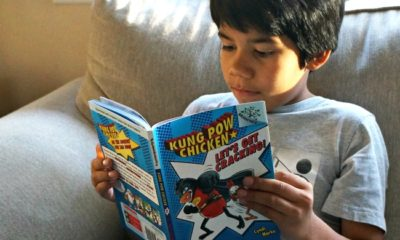 Boy reading Kung Pow Chicken