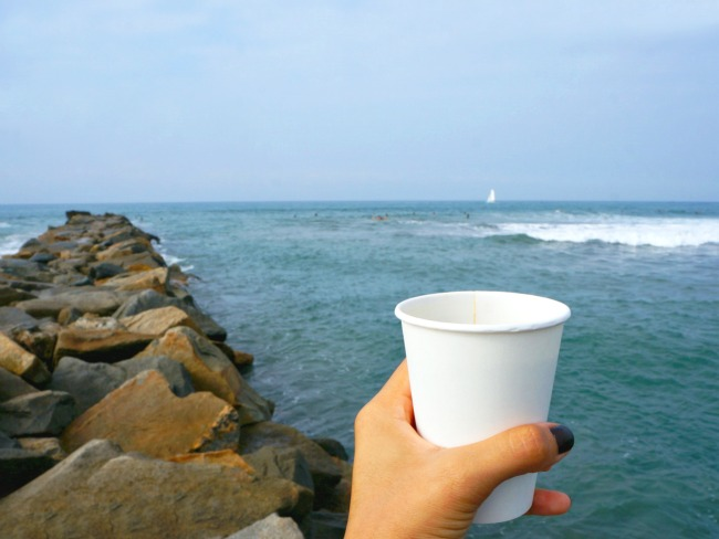 Coffee with ocean background