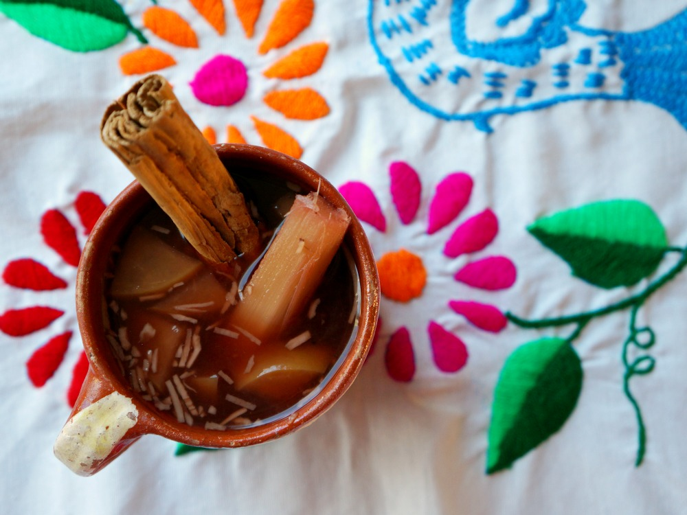 How to make Mexican punch (Ponche Navideño) using a simple recipe at home. Great for a big crowd! LivingMiVidaLoca.com | #MexicanRecipe #MexicanPunch #ChristmasPunch #TraditionalMexicanPunch #PoncheNavideno #RumPunch #ChristmasRecipes #ChristmasPartyRecipes