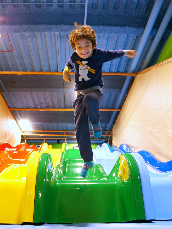 Boy jumping from colorful slides at Billy Beez in Anaheim // LivingMiVidaLoca.com