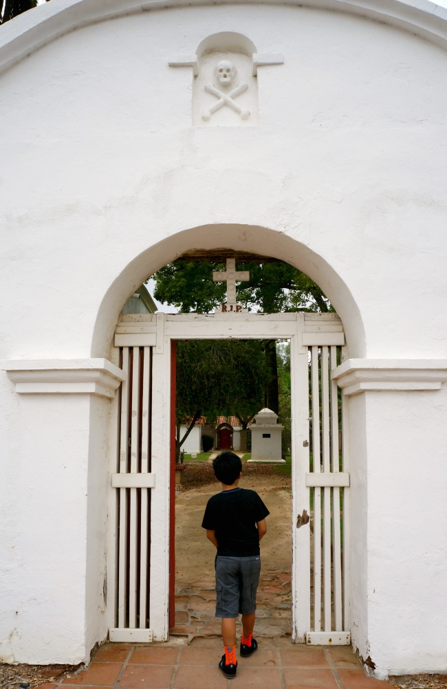 The skull and crossbones above the cemetery entrance is commonly found at Franciscan cemeteries.