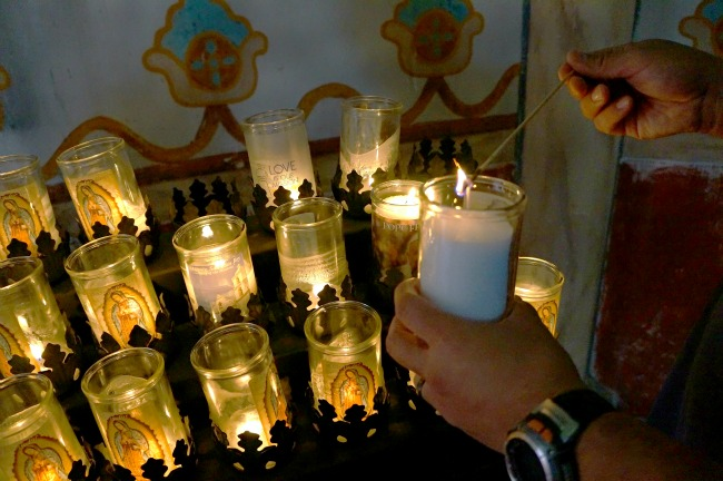 lighting-candle-at-church