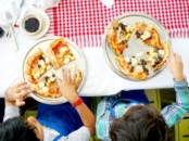 Kids eating pizza at Naples Ristorante // Pizza Party at Downtown Disney // LivingMiVidaLoca.com
