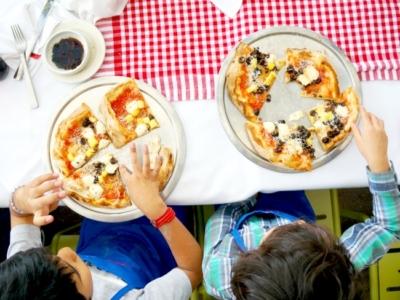 Kids eating pizza at Naples Ristorante // Pizza Party at Downtown Disney // LivingMiVidaLoca.com