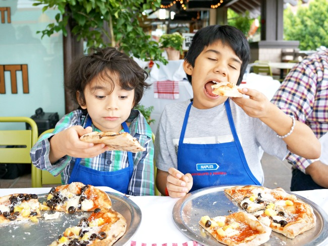 Latino kids eating pizza at Naples Ristorante // Pizza Party at Downtown Disney // LivingMiVidaLoca.com