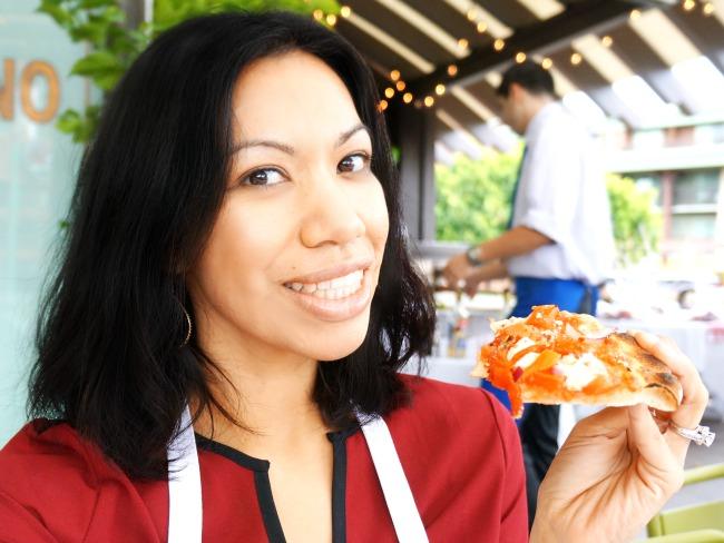 Pattie Cordova eating pizza // Pizza Party at Downtown Disney // LivingMiVidaLoca.com
