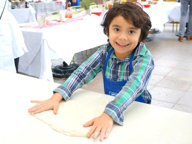 boy making pizza // Pizza Party at Downtown Disney // LivingMiVidaLoca.com