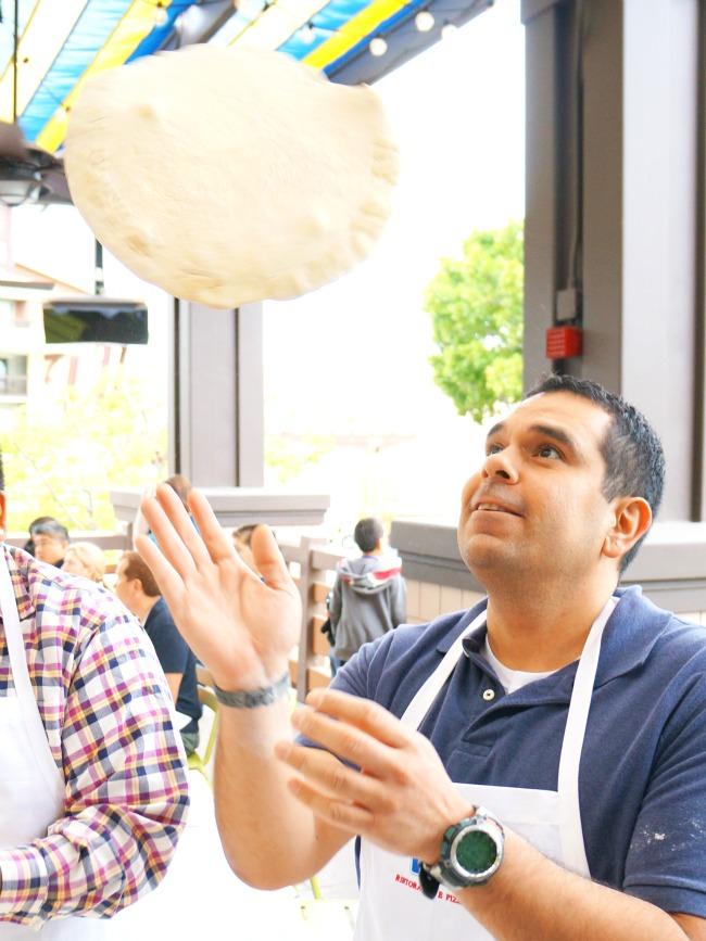 tossing pizza dough // Pizza Party at Downtown Disney // LivingMiVidaLoca.com