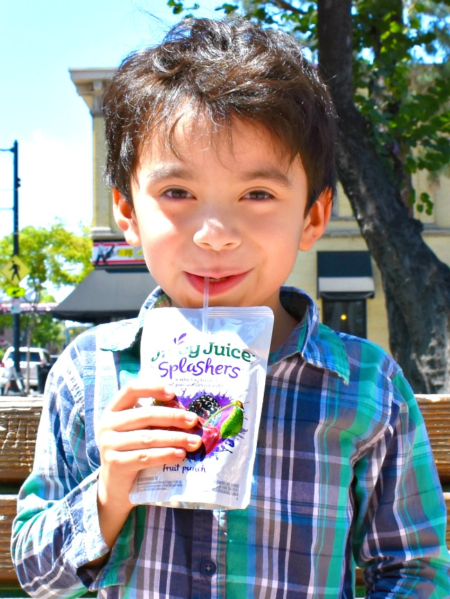 Boy drinking Juicy Juice Splashers // Afternoon dates with my preschooler // LivingMiVidaLoca.com