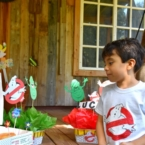 Boy looking at Krispy Kreme doughnuts : Ghostbuster birthday party : LivingMiVidaLoca.com (photo credit: Pattie Cordova)