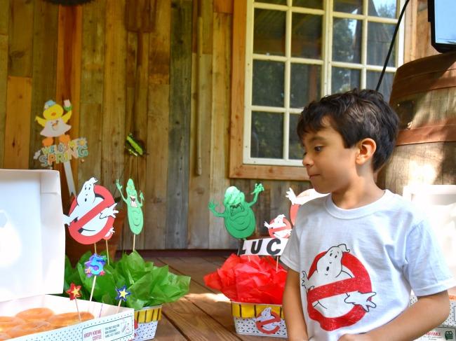 Boy looking at Krispy Kreme doughnuts : Ghostbuster birthday party : LivingMiVidaLoca.com (photo credit: Pattie Cordova)