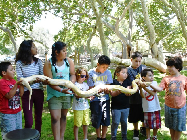 Kids holding giant banana snake - Ghostbuster birthday party - LivingMiVidaLoca.com - #LivingMiVidaLoca #birthdaypartyideas #Ghostbusters