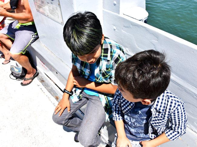 kids-sitting-on-ferry-ride