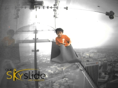 Lucas on the Skyslide at OUE SkySpace LA