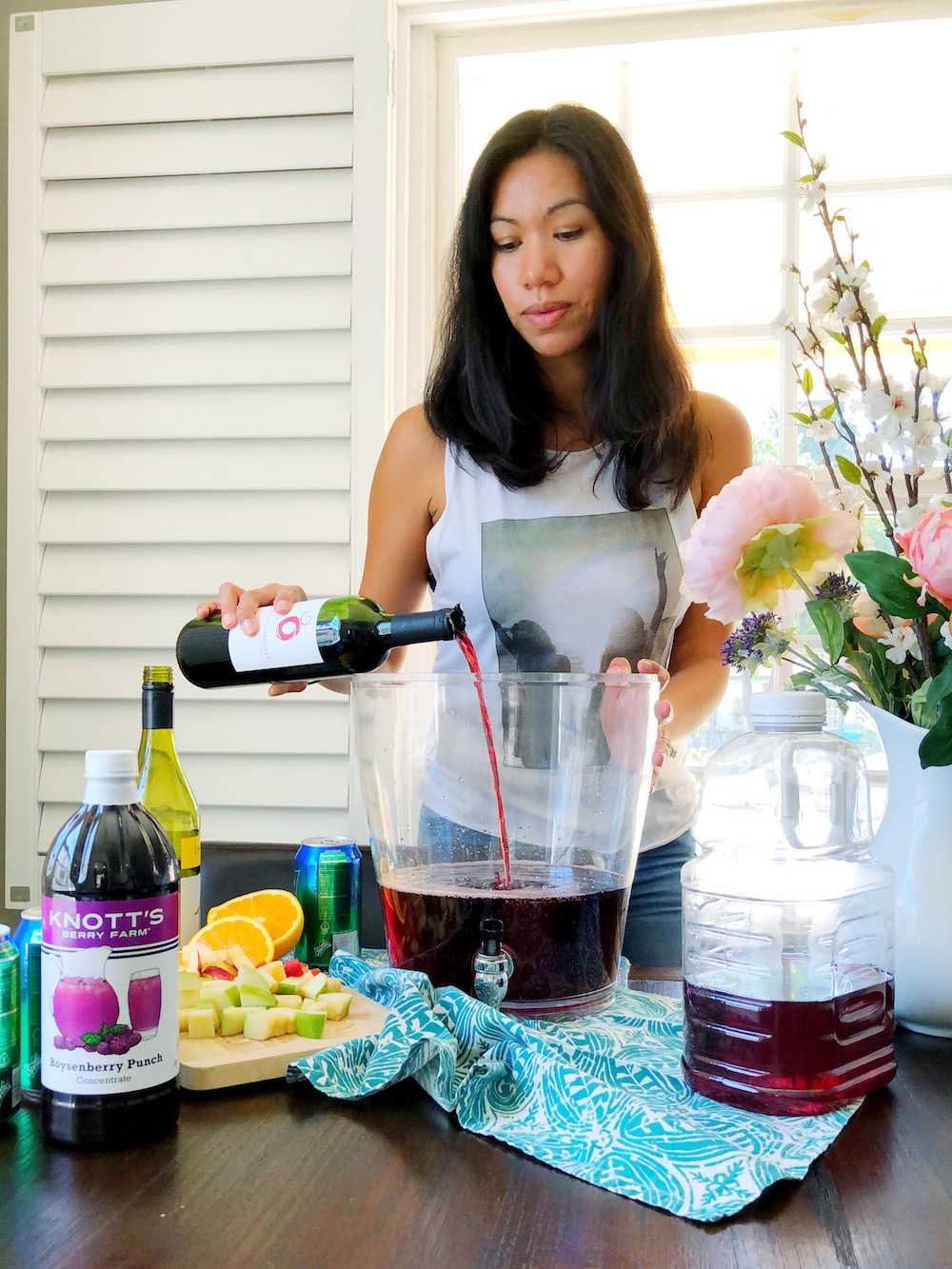 pouring wine into boysenberry sangria