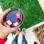 cup of boysenberry sangria outside on lawn