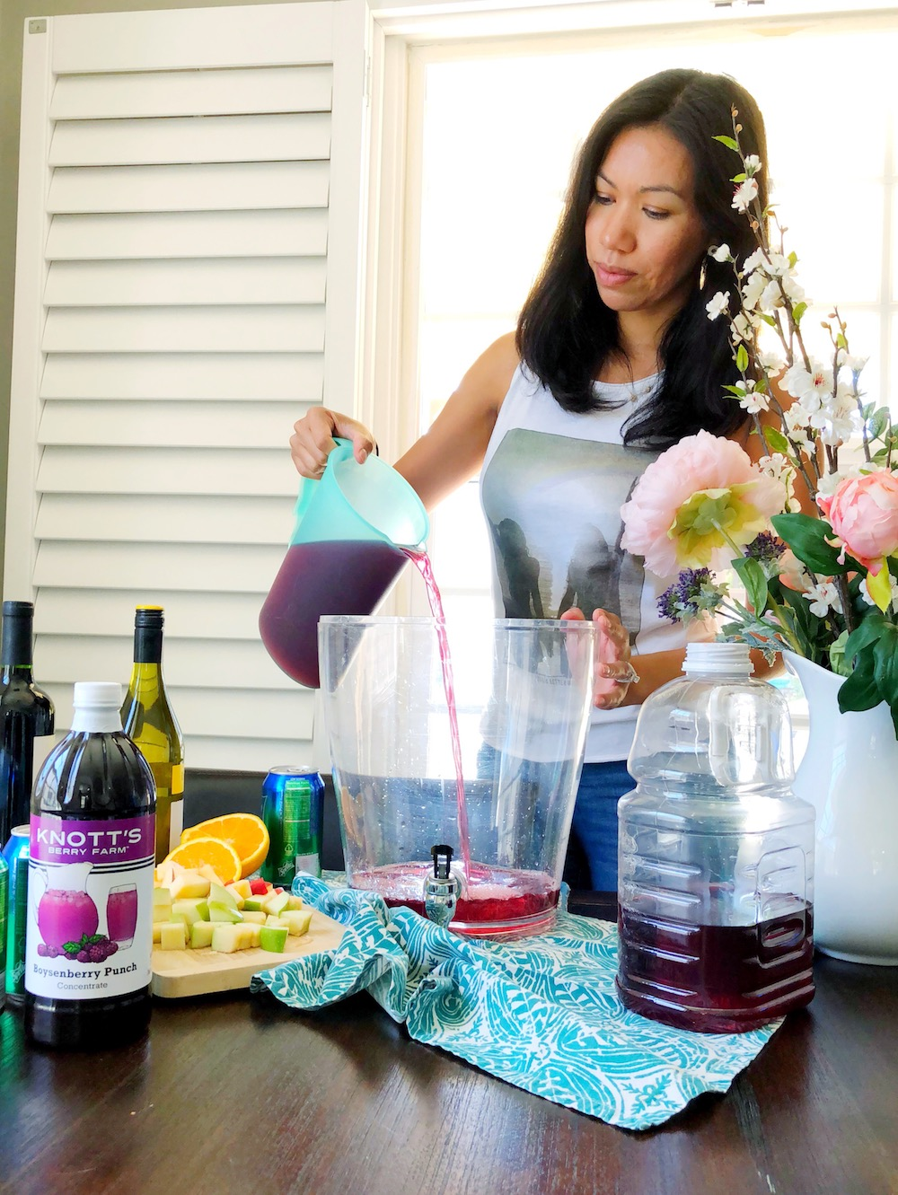 pouring juice into boysenberry sangria