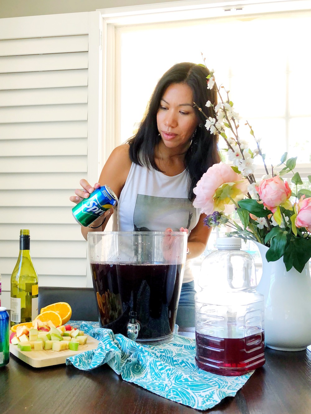 pouring soda into boysenberry sangria