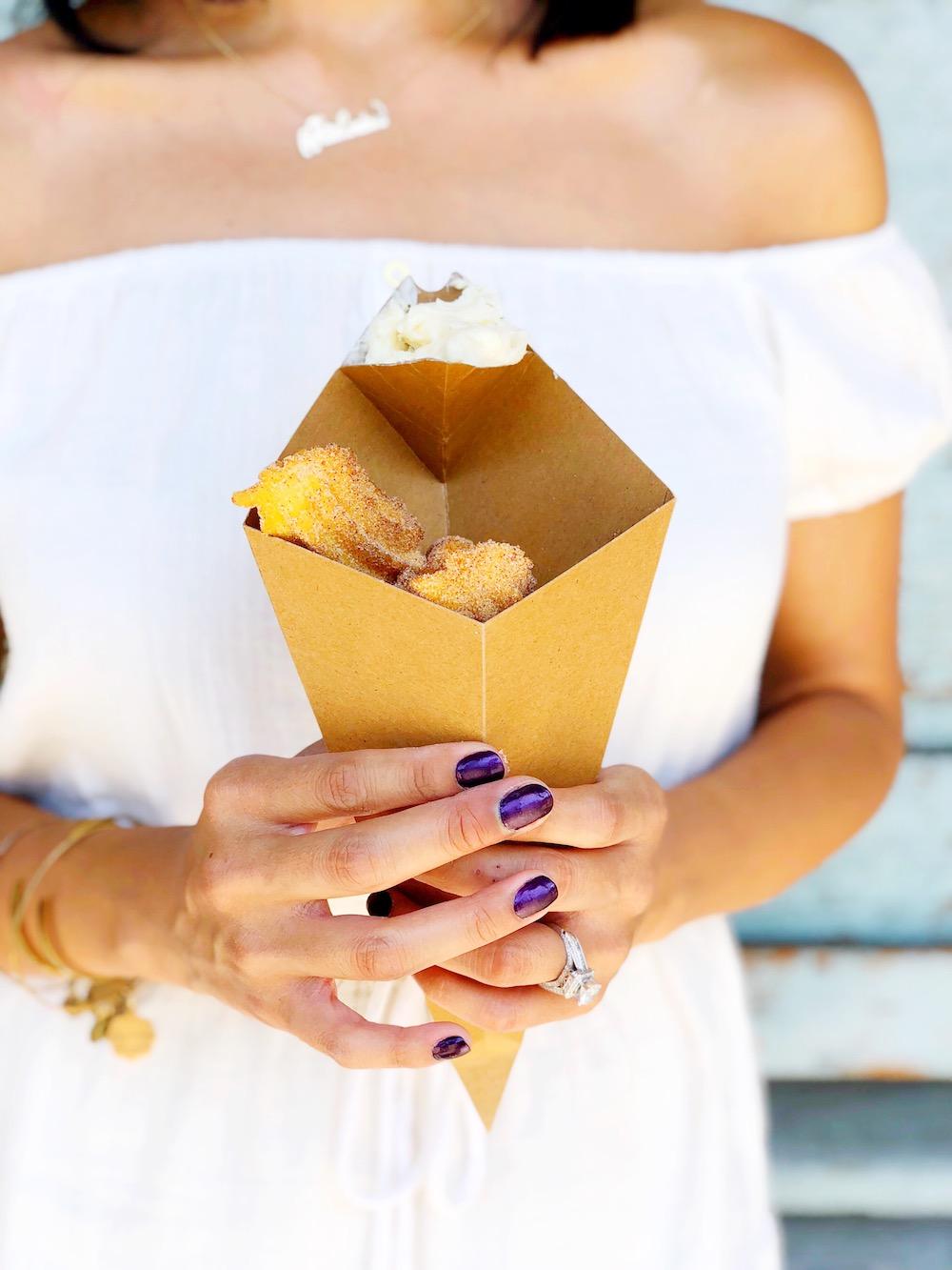 Churro bites with dulce de leche dipping sauce in cone container - livingmividaloca.com
