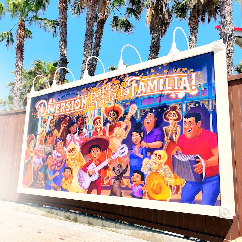 Coco billboard at Pixar Pier - livingmividaloca.com - #pixarpier #disneyland #disneycaliforniaadventure. Click for more things to do in Anaheim besides Disneyland.
